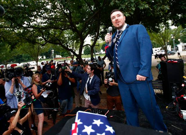 The Latest: Anti-fascists confront police in Washington