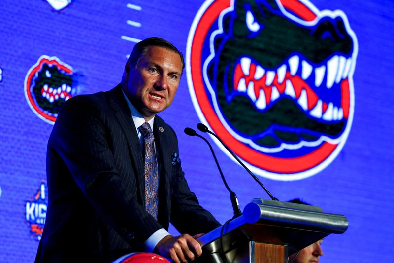 The Latest: Mullen hopes Gators make big leap in Year 2